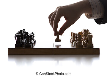 hand of man making a move chess figure