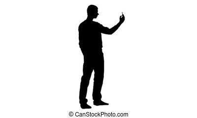 Man makes selfi in the phone. White background. Silhouette