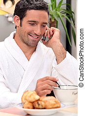 Man making a call over breakfast
