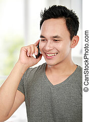 man making a phone call - Handsome young man making a phone...