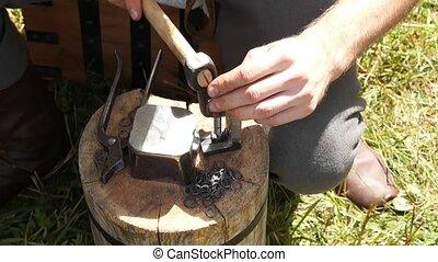 man making chain armor, blacksmith - man making chain armor,...