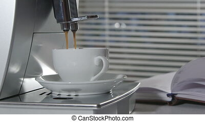Man making cup of espresso using coffee machine at office or home