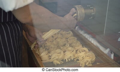 Man making fresh Italian style pasta - Closeup hands of man...