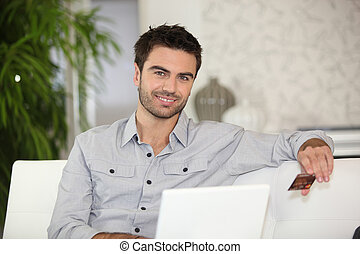 Man making online purchase