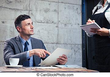 Man making order at restaurant - Confident man making order ...