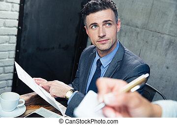 Man making order at restaurant - Handsome man making order ...