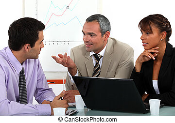 Man making point in business meeting