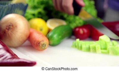 man making salad in kitchen