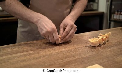 Man making tortellini, a traditional Italian food - Hands of...