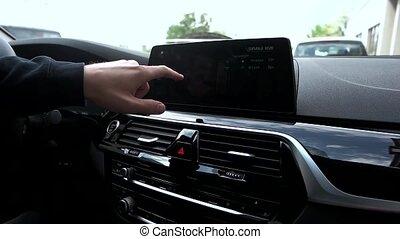 Man manages car menu on digital dashboard
