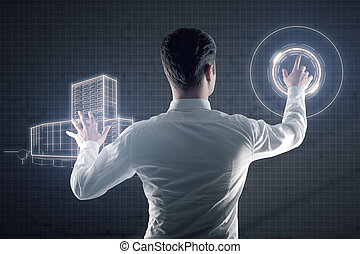 Man managing digital construction project - Back view of...