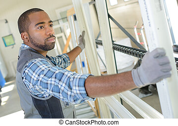 Man manufacturing upvc windows
