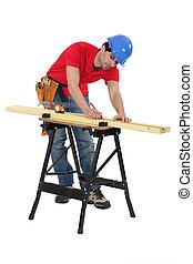 Man marking timber