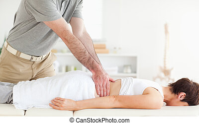 Man massaging a cute woman's back in a room