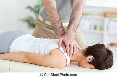 Man massaging a woman