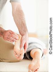 Man massaging a woman's feet