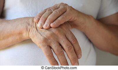 man massaging back of his hand