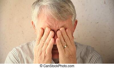 man massaging eye area