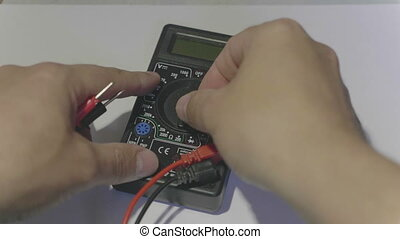 Man measures digital multimeter. FHD stock footage.