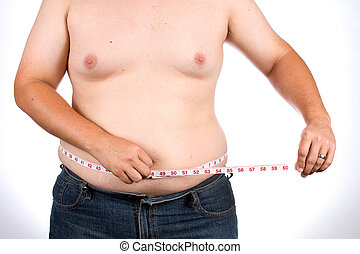 Man Measures Waist - Overweight man uses a fabric tape to...