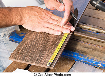Man measuring a tile piece