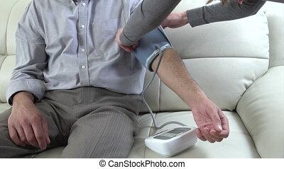 Man measuring his blood pressure. - Senior man measuring his...