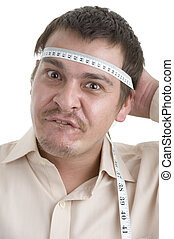 man measuring his head