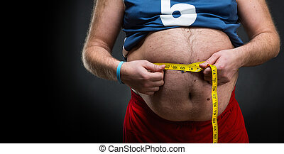 Man measuring his waist - Fat man measuring his big belly...