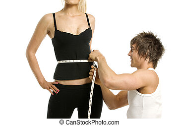 Man measuring woman isolated on a white background
