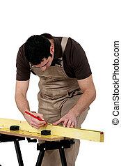 Man measuring wooden plank