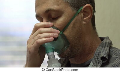 Man Medical Nebulizer Closeup Side - Close up side view shot...