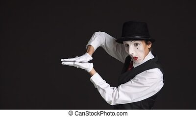 man mime, showing the growth and decline of Finance on a black background