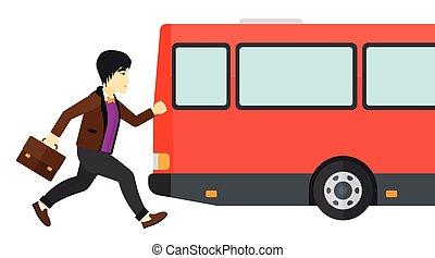Man missing bus. - Latecomer man running along the sidewalk...