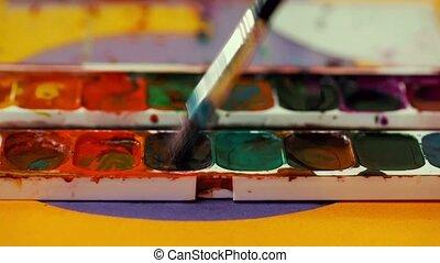 Man mix gouache paint together