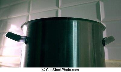 Man mixing boiled rice in big pan on cooker. 4K video - Man...