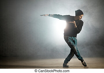 man mixing styles of dance. ballet motion on the street dance