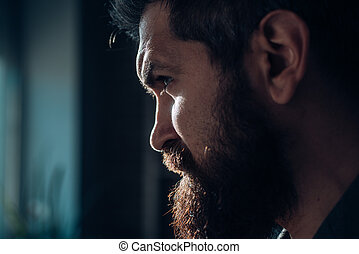 Man model. Portrait of sexy man. Close up cropped half face portrait of attractive man stand isolated on light gray background with copy space. Bearded guy.