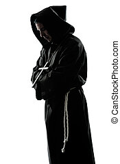 one caucasian man priest praying silhouette in studio isolated on white background