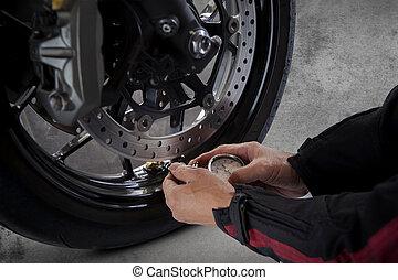 man motorcycle tire manual air pressure testing before...