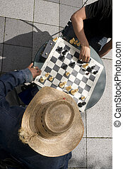 Man Moves Piece People Playing Chess Game Sidewalk Park Downtown