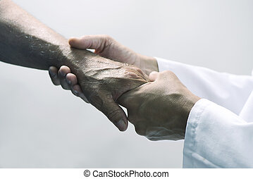 man moving the hand of a senior patient