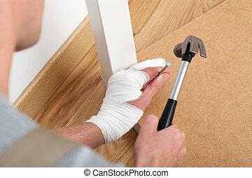 Man nailing with a hammer