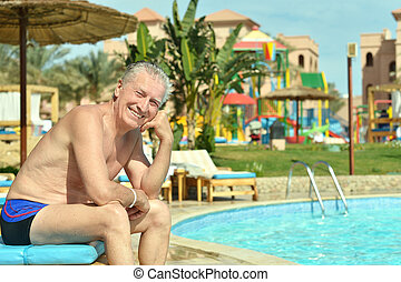 man near swimming pool