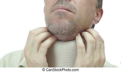 Man Neck Support Brace Scratching - Close up shot of a man...