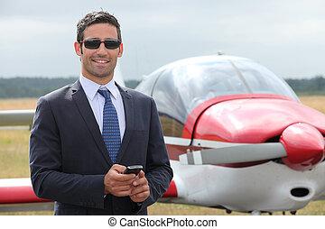 Man next to a light aircraft