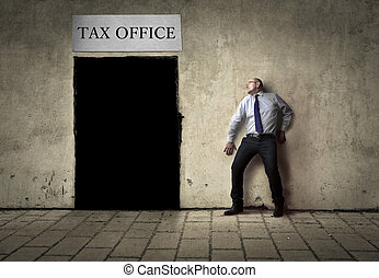 Man next to tax office - Man hiding from tax office