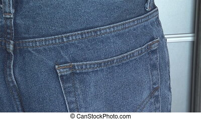 man nonchalantly hiding money in your back pocket