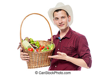 Man of 30 years with vegetables in a basket on a white background