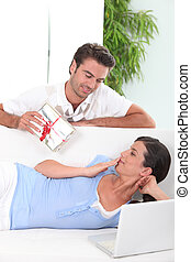 Man offering gift to wife