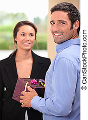 Man offering gift to woman